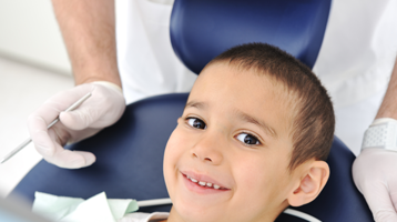 featured-image_0002_shutterstock_kid-on-dentist-chair